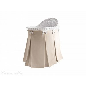 Mobile wicker bassinet with beige skirt