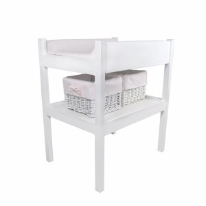 Changing table with baby pink equipment