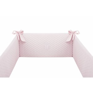Baby pink cot bumper with emblem