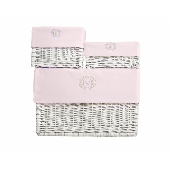 White wicker boxes with pink linen and gold emblem